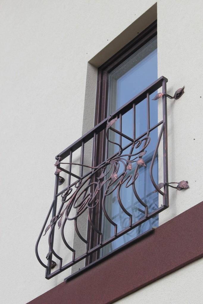 Балконные ограждения и кованые балконы цена. кованые цветочн.